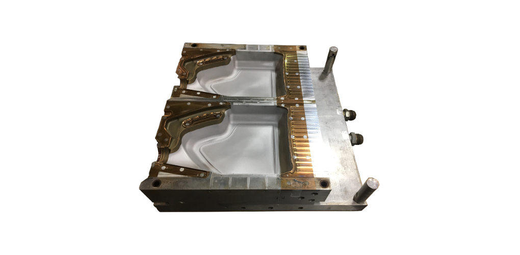A blow mold for molding plastic jugs.